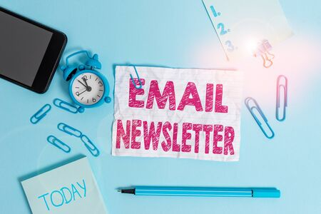 Text sign showing Email Newsletter. Business photo showcasing email sent out to inform the audience of the latest news Alarm clock clips notepad smartphone rubber band marker colored background Stock fotó
