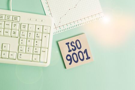 Conceptual hand writing showing Iso 9001. Concept meaning designed help organizations to ensure meet the needs of customers Paper blue keyboard office study notebook chart numbers memo