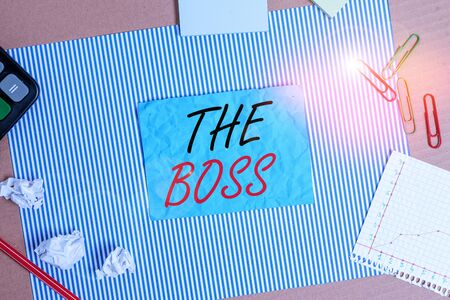 Handwriting text The Boss. Conceptual photo a demonstrating who exercises control or authority in the organization Striped paperboard notebook cardboard office study supplies chart paper
