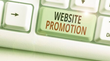 Writing note showing Website Promotion. Business concept for increase exposure of a website to bring more visitors 版權商用圖片
