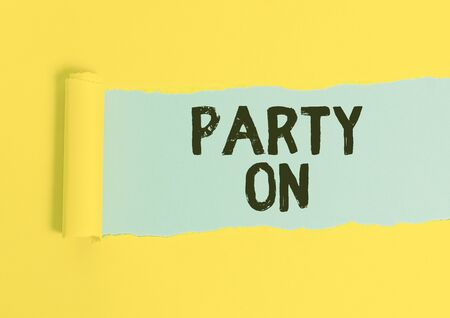 Writing note showing Party On. Business concept for Keep or continue having a great time even after something happens Cardboard which is torn placed above a wooden classic table
