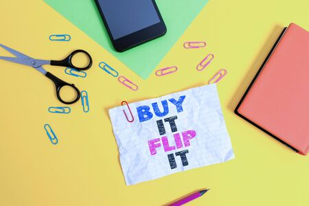 Text sign showing Buy It Flip It. Business photo text Buy something fix them up then sell them for more profit Paper sheets pencil clips smartphone scissors notebook colored background Stock fotó