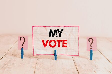 Handwriting text My Vote. Conceptual photo the act of showing your choice or opinion in an election or meeting Scribbled and crumbling sheet with paper clips placed on the wooden table