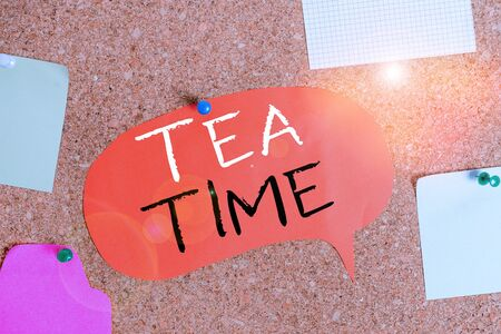 Handwriting text Tea Time. Conceptual photo the time in the afternoon when some showing eat a small meal Corkboard color size paper pin thumbtack tack sheet billboard notice board Stock Photo