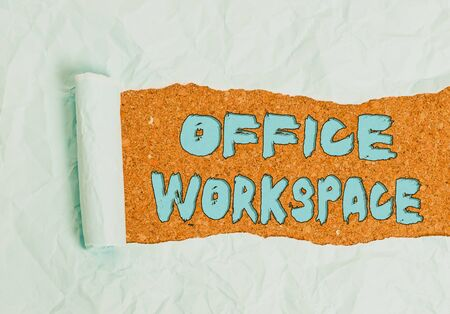 Word writing text Office Workspace. Business photo showcasing any location or venue where demonstrating work is performed Cardboard which is torn in the middle placed above a wooden classic table