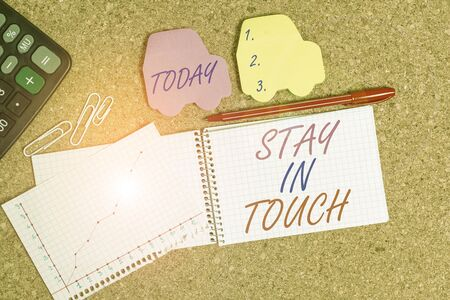 Text sign showing Stay In Touch. Business photo text Keep Connected thru Phone Letters Visit Email Social Media Desk notebook paper office cardboard paperboard study supplies table chart