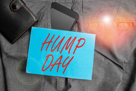 Conceptual hand writing showing Hump Day. Concept meaning climbing a proverbial hill to get through a tough week Wednesday Smartphone device inside trousers front pocket with wallet