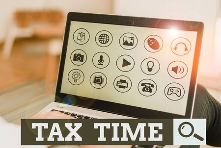 Writing note showing Tax Time. Business concept for compulsory contribution state revenue levied government on workers