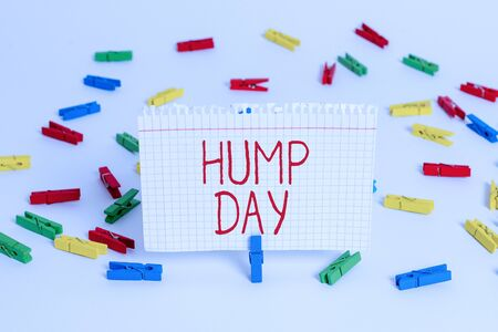 Writing note showing Hump Day. Business concept for climbing a proverbial hill to get through a tough week Wednesday Colored clothespin papers empty reminder white floor background office Фото со стока