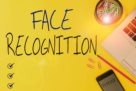 Text sign showing Face Recognition. Business photo showcasing ability of a computer to scan and recognize huanalysis faces Slim trendy laptop pencil smartphone clips container colored background