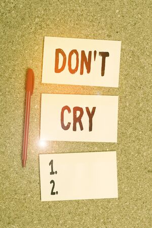 Conceptual hand writing showing Don T Cry. Concept meaning Shed tears typically as an expression of distress pain or sorrow Empty sticker reminder memo billboard corkboard desk paper