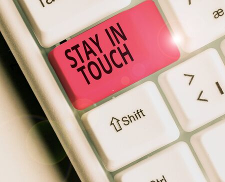 Conceptual hand writing showing Stay In Touch. Concept meaning Keep Connected thru Phone Letters Visit Email Social Media