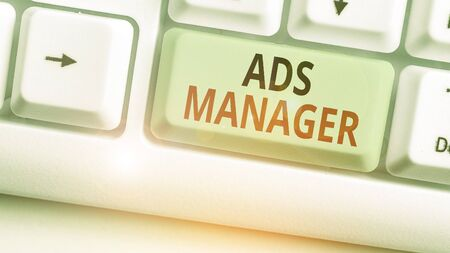 Writing note showing Ads Analysisager. Business concept for oversee and control the various advertising activities