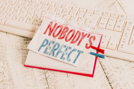Text sign showing Nobody S Is Perfect. Business photo text used to say that everyone makes mistakes or fault notebook paper reminder clothespin pinned sheet white keyboard light wooden