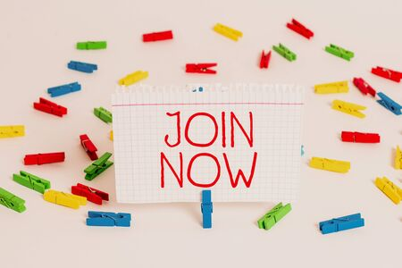 Writing note showing Join Now. Business concept for An invite to a demonstrating or a friend to become a member of the group Colored clothespin papers empty reminder white floor background office