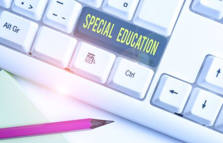 Conceptual hand writing showing Special Education. Concept meaning form of learning given to students with mental challenges White pc keyboard with note paper above the white background Zdjęcie Seryjne