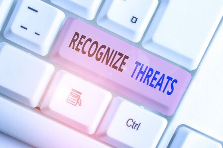 Writing note showing Recognize Threats. Business concept for potential to cause serious harm to a computer system