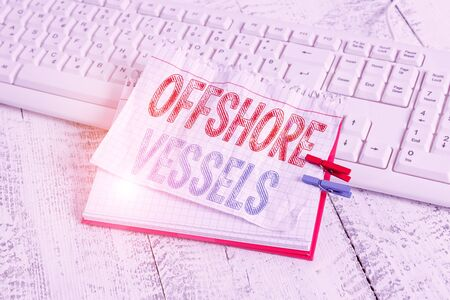 Text sign showing Offshore Vessels. Business photo text ship designed to supply offshore oil and gas platforms notebook paper reminder clothespin pinned sheet white keyboard light wooden Zdjęcie Seryjne