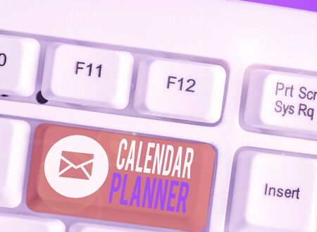 Writing note showing Calendar Planner. Business concept for schedule of activities or task that must be completed