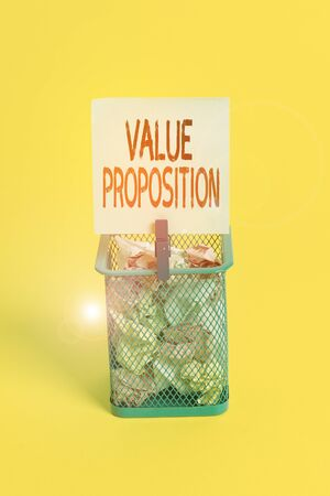 Conceptual hand writing showing Value Proposition. Concept meaning make a company or product attractive to customers Trash bin crumpled paper clothespin office supplies yellow