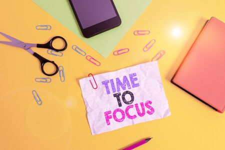 Text sign showing Time To Focus. Business photo text Give full attention to something or activity Key to success Paper sheets pencil clips smartphone scissors notebook colored background