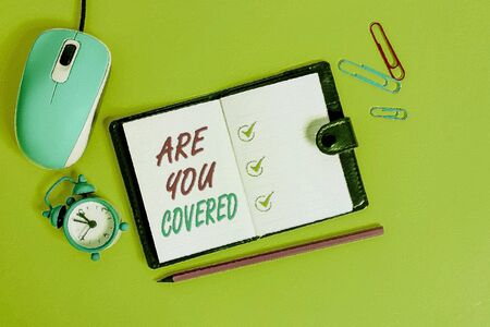 Word writing text Are You Covered. Business photo showcasing Asking about how medications are covered by your plan Locked diary sheets clips marker mouse alarm clock colored background