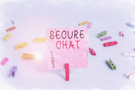 Handwriting text Secure Chat. Conceptual photo approach to protect messages when sent beyond the corporate Colored clothespin rectangle square shaped paper light blue background Banco de Imagens