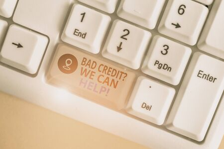 Writing note showing Bad Credit Question We Can Help. Business concept for offering help after going for loan then rejected White pc keyboard with note paper above the white background