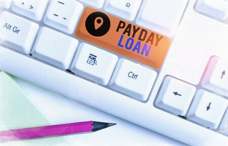 Word writing text Payday Loan. Business photo showcasing Something lent or furnished on condition being returned White pc keyboard with empty note paper above white background key copy space