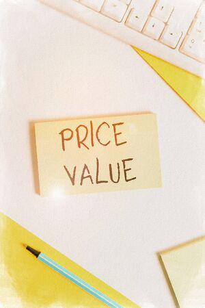 Text sign showing Price Value. Business photo showcasing the price of a product based on what customers think or valued Flat lay above table with pc keyboard and copy space paper for text messages