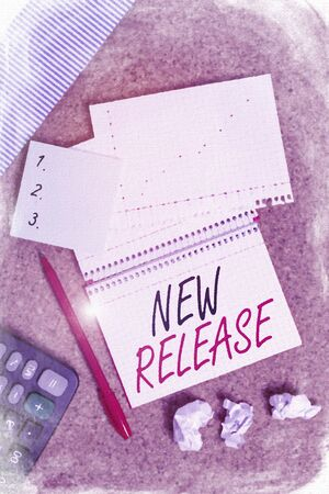 Conceptual hand writing showing New Release. Concept meaning announcing something newsworthy recent product in the market Desk notebook paper office paperboard study supplies chart 스톡 콘텐츠