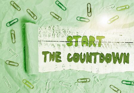 Writing note showing Start The Countdown. Business concept for Sequence of Backward Counting to Set the Timer Paper clip and torn cardboard on wood classic table backdrop