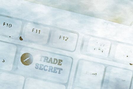 Writing note showing Trade Secret. Business concept for technique used by a company in analysisufacturing its products White pc keyboard with note paper above the white background