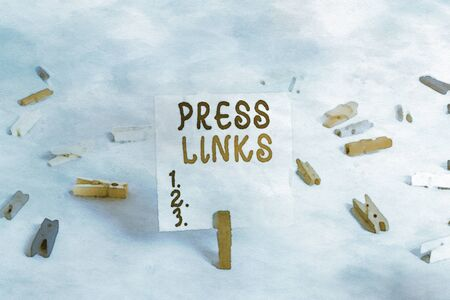 Handwriting text Press Links. Conceptual photo intended to analysisipulate a site s is ranking in Google search Colored clothespin rectangle square shaped paper light blue background