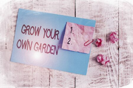 Word writing text Grow Your Own Garden. Business photo showcasing Organic Gardening collect demonstratingal vegetables fruits Wrinkle paper and cardboard plus stationary placed above wooden background