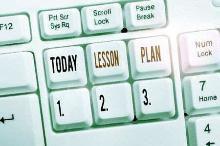 Writing note showing Lesson Plan. Business concept for a teacher s is detailed description of the course of instruction Keyboard with note paper on white background key copy space Banco de Imagens