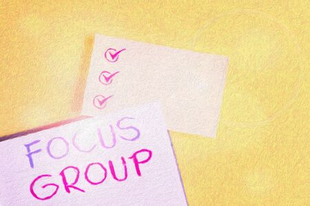 Conceptual hand writing showing Focus Group. Concept meaning showing assembled to participate in discussion about something Empty orange paper with copy space on the yellow table