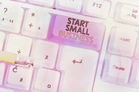 Writing note showing Start Small Business. Business concept for Aspiring Entrepreneur a New Venture Trade Industry White pc keyboard with note paper above the white background Banco de Imagens