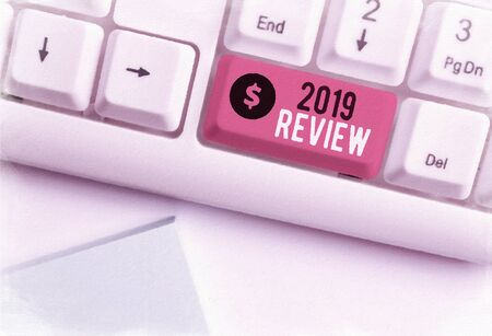 Word writing text 2019 Review. Business photo showcasing New trends and prospects in tourism or services for 2019 White pc keyboard with empty note paper above white background key copy space