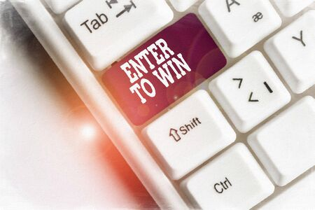 Text sign showing Enter To Win. Business photo showcasing exchanging something value for prize or chance of winning White pc keyboard with empty note paper above white background key copy space