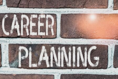 Writing note showing Career Planning. Business concept for Strategically plan your career goals and work success Front view red brick wall facade background Old grunge scenery