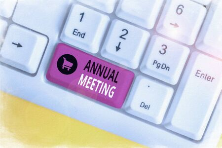 Handwriting text Annual Meeting. Conceptual photo yearly meeting of the general membership of an organization White pc keyboard with empty note paper above white background key copy space