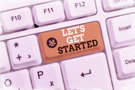 Conceptual hand writing showing Let S Is Get Started. Concept meaning to begin doing or working on something you had started White pc keyboard with note paper above the white background