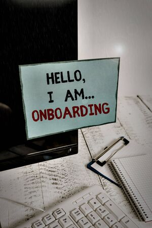 Writing note showing Hello I Am Onboarding. Business concept for telling demonstrating that you are on ship or plane Note paper taped to black computer screen near keyboard and stationary Standard-Bild