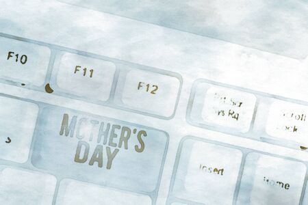 Conceptual hand writing showing Mother S Day. Concept meaning a celebration honoring the mother of the family or motherhood White pc keyboard with note paper above the white background