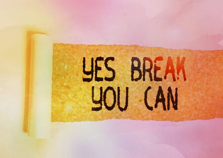 Conceptual hand writing showing Yes break You Can. Concept meaning Positivity Encouragement Persuade Dare Confidence Uphold Cardboard which is torn placed above a wooden classic table Imagens