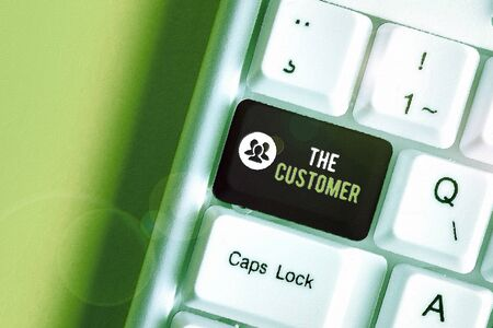 Text sign showing The Customer. Business photo text demonstrating or organization that buys goods or services from a store White pc keyboard with empty note paper above white background key copy space Stock Photo