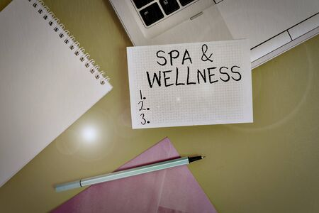 Conceptual hand writing showing Spa And Wellness. Concept meaning Place where showing go to improve their health Relaxation Laptop marker square sheet spiral notebook color background