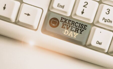 Handwriting text writing Exercise Every Day. Conceptual photo move body energetically in order to get fit and healthy White pc keyboard with empty note paper above white background key copy space