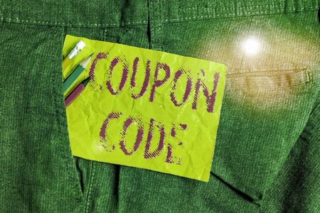 Word writing text Coupon Code. Business photo showcasing ticket or document that can be redeemed for a financial discount Writing equipment and yellow note paper inside pocket of man work trousers